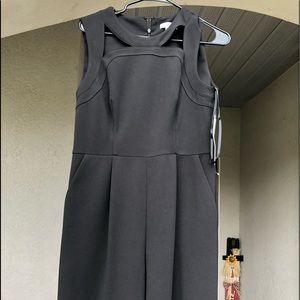Black Calvin Klein jumpsuit with pockets.